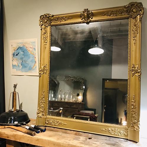 Miroir en bois laqué début XXe