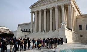 People outside of the Supreme Court building People stand in line to enter the Supreme Court in December 2017. (Jacquelyn Martin / AP)