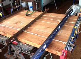 """2"""" AFRICAN MAHOGANY TABLE TOP BEING GLUED"""