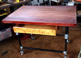 """2"""" AFRICAN MAHOGANY TABLE'S LEGS BEING INSTALLED"""