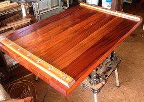 "TUNG OIL FINISH BEING APPLIED ON 2"" AFRICAN MAHOGANY TABLE"