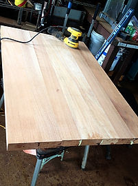 """2"""" AFRICAN MAHOGANY TABLE TOP BEING SANDED"""