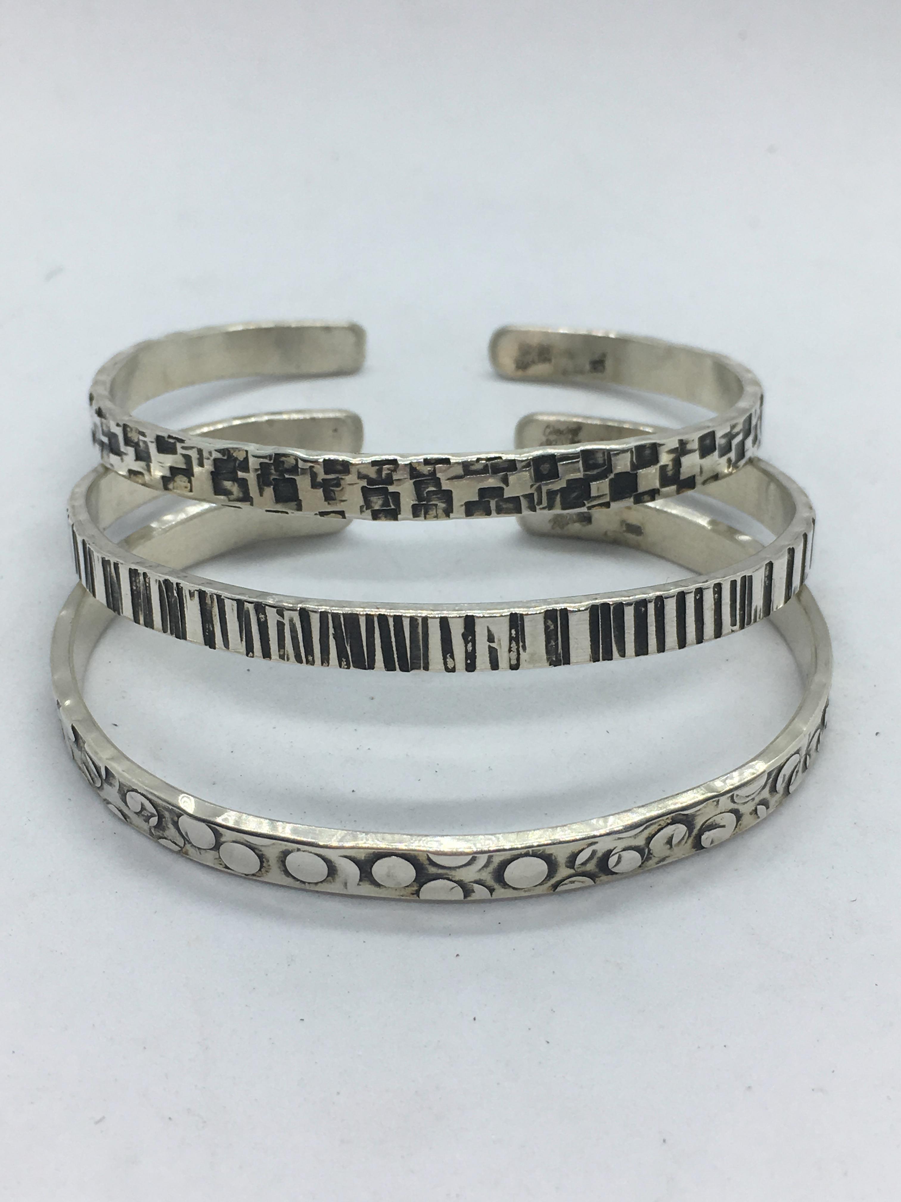 Textured silver cuffs