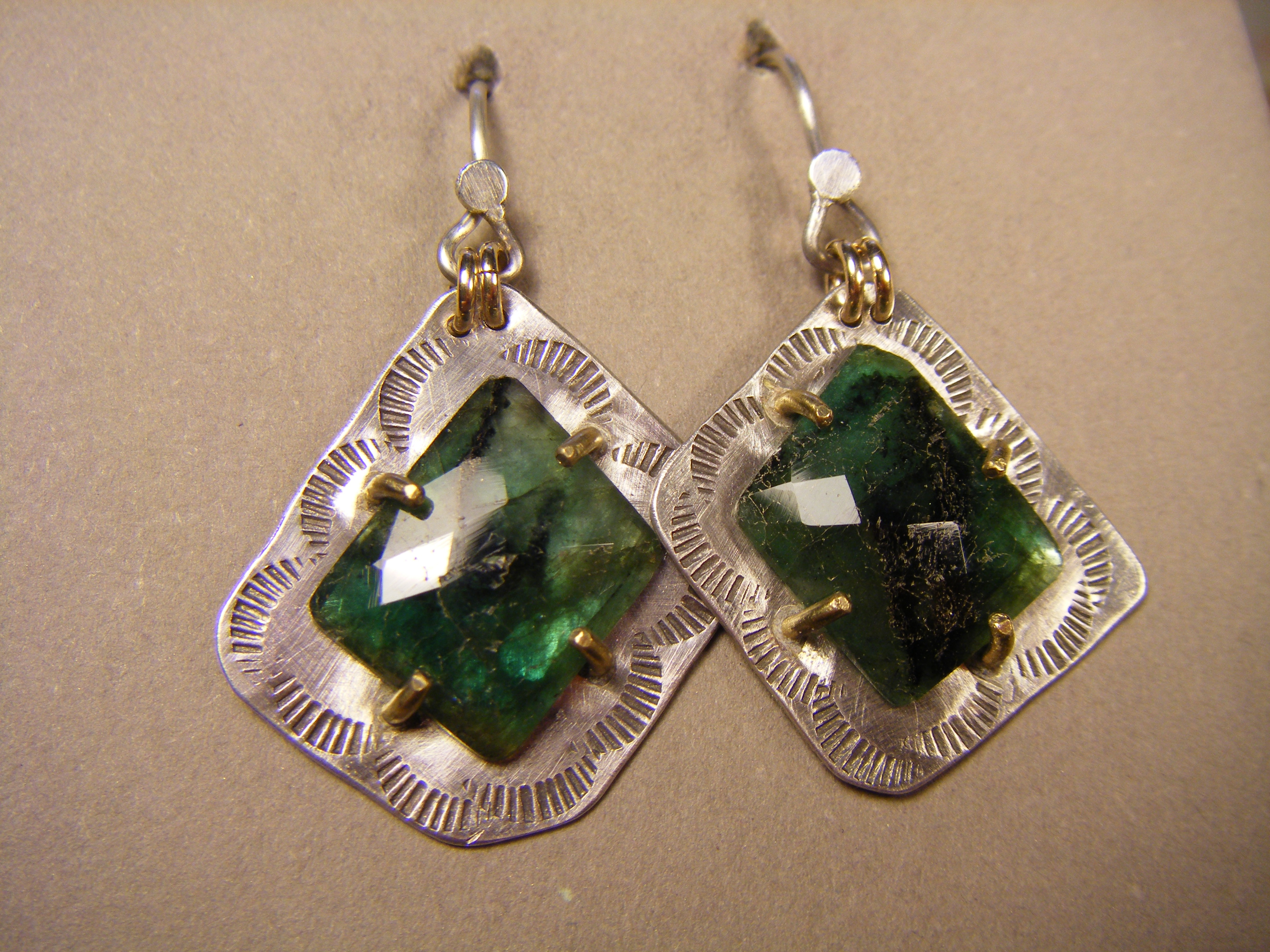 Emeralds w/22kt prongs on silver