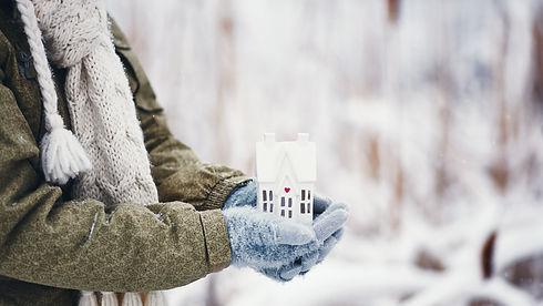 iStock-998188390 - house in hands winter