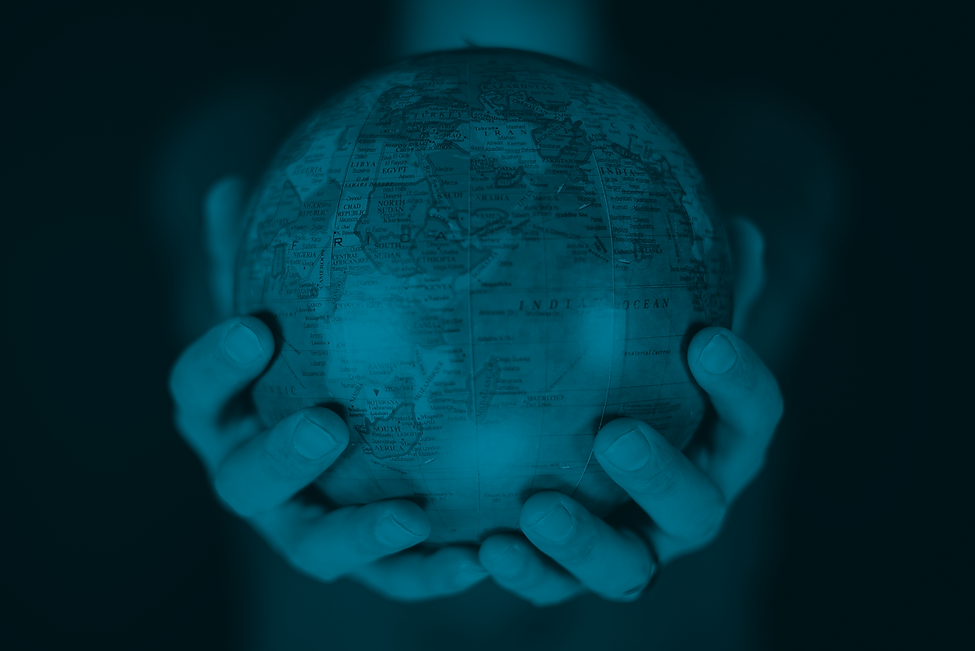 closeup-shot-person-holding-small-globe-with-two-hands.png