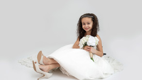 A little girl in mommy's wedding gown!