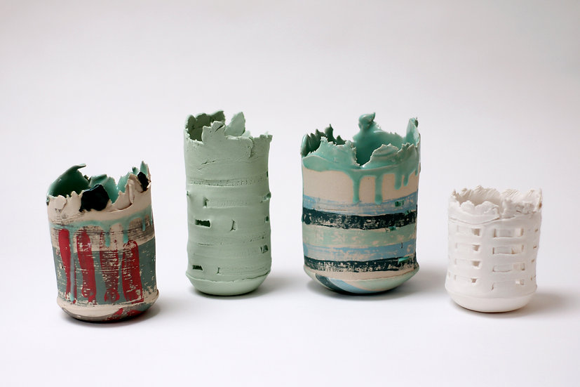 (Second from left) Small Green Stained Porcelain