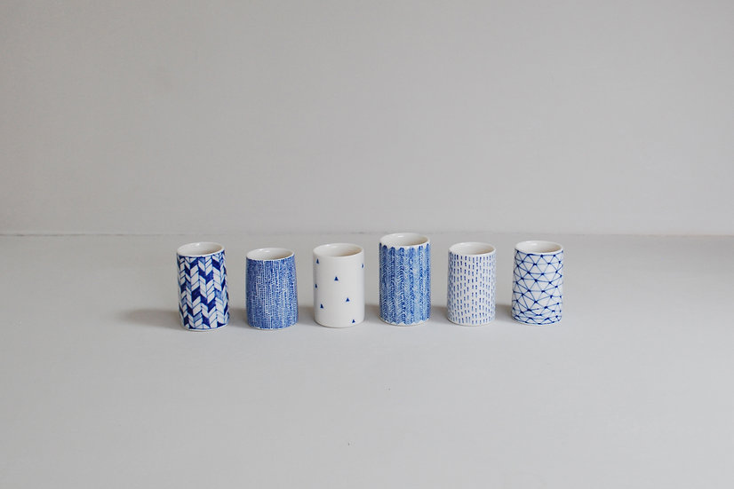 Row of Tiny Cylinders | By Tamsin Arrowsmith-Brown