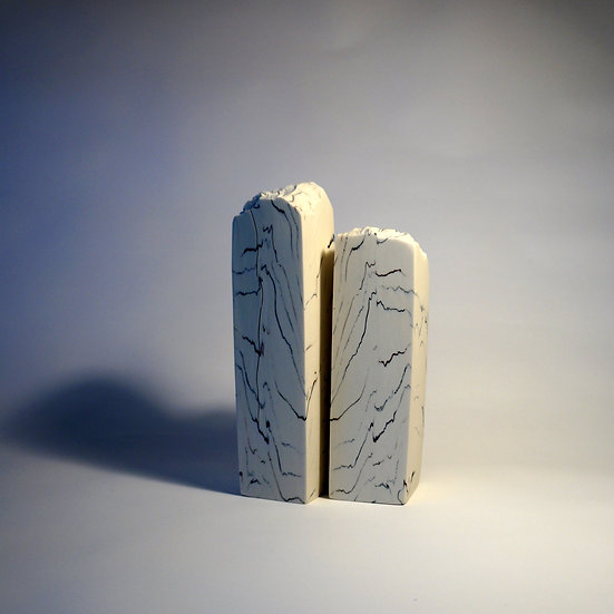 2 solid porcelain columns cut from the same block of geological  | Kim Colebrook