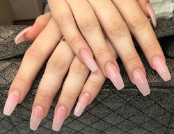 Sheer pink acrylic nails built on tips