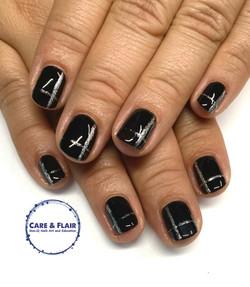 Black gel polish, silver detail.