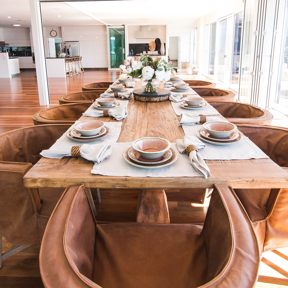 Wooden table with beautiful table setting.