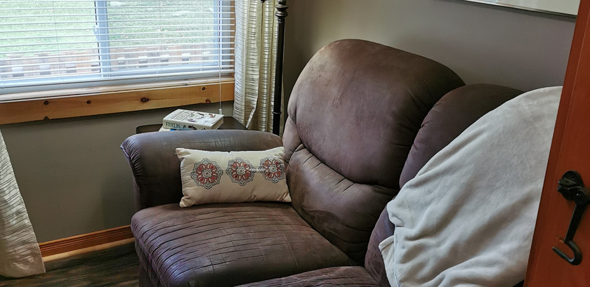 Love seat in front bedroom
