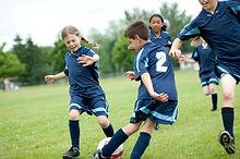 kids playing football.jpg