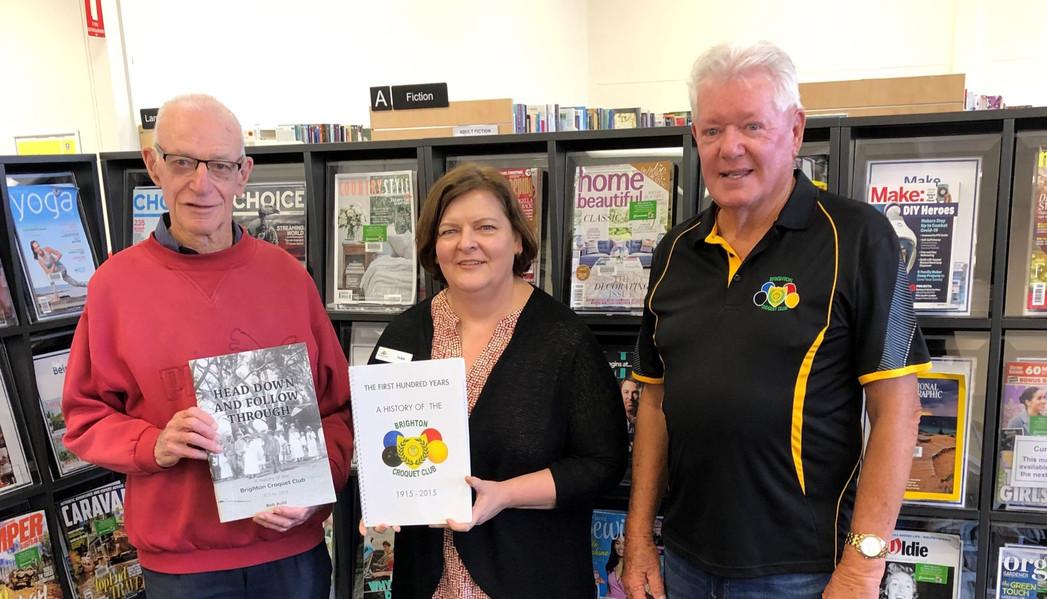 Presentation of BCC historybooks to Brighton Library