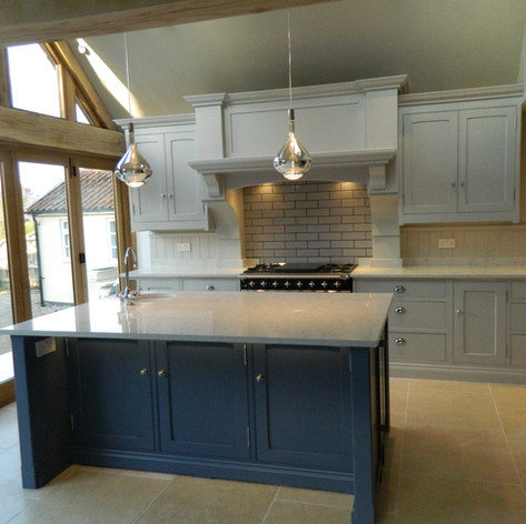 Another of our classic farm house kitchens using F&B colors giving a striking multi tonal finish. Accompanied with beautiful white quartz worktops.