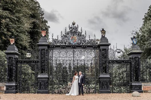 Bride and groom outside Sandringham, Norfolk