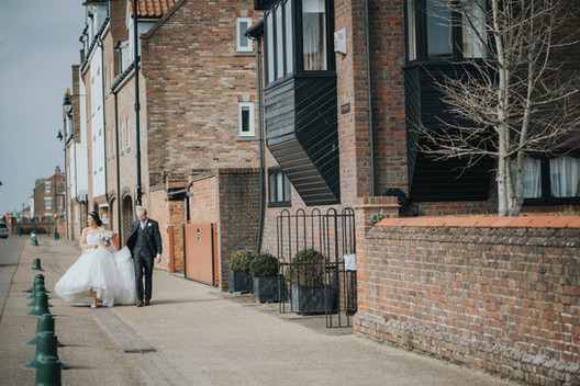 couple walk through kings lynn