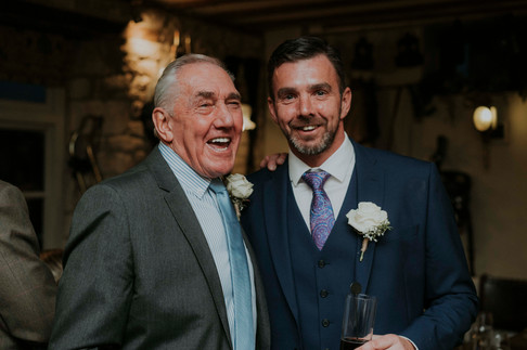 father and son picture on wedding day