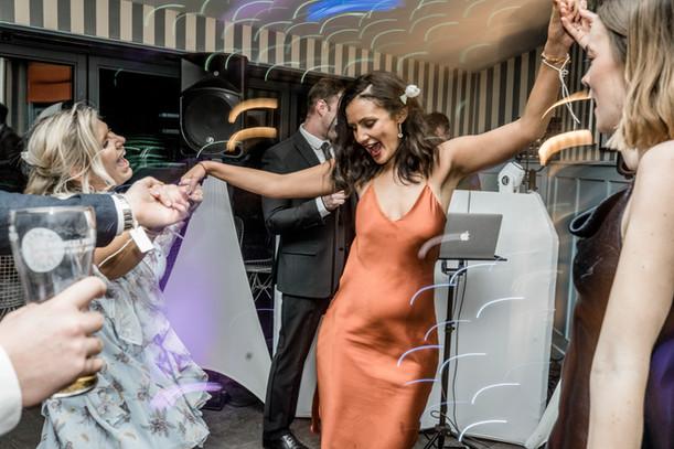 Friends dancing at wedding in norfolk