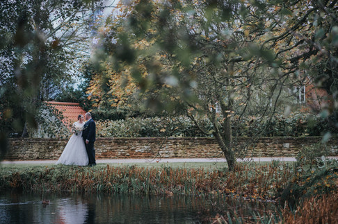 husband and wife have wedding pictures at heacham manor
