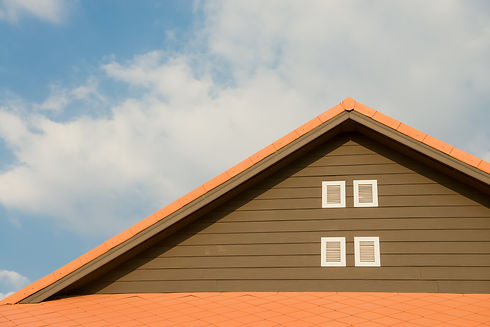 orange-and-gray-painted-roof-under-cloud