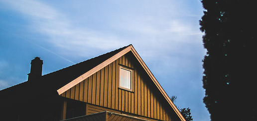 brown-wooden-house-under-blue-sky-at-day