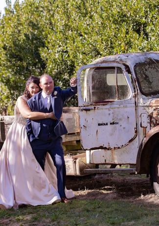 Bride & Groom Infront of Old Car