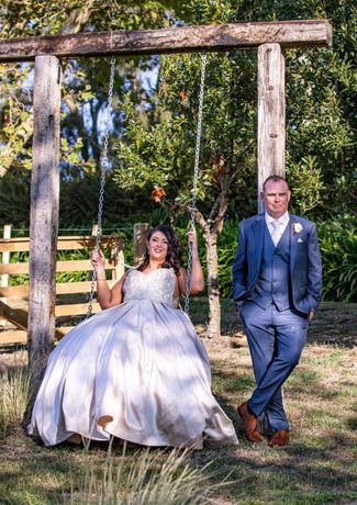 Bride On Swing With Groom