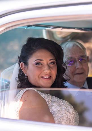Bride Sitting In Car
