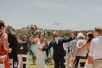 Bride & Groom Celebrate Walking Down The Aisle Right After Ceremony