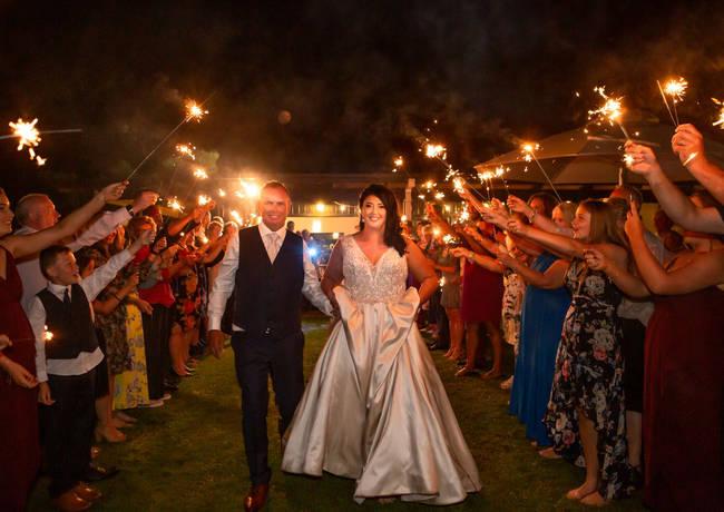 Bride & Groom walk down sparkler tunnel