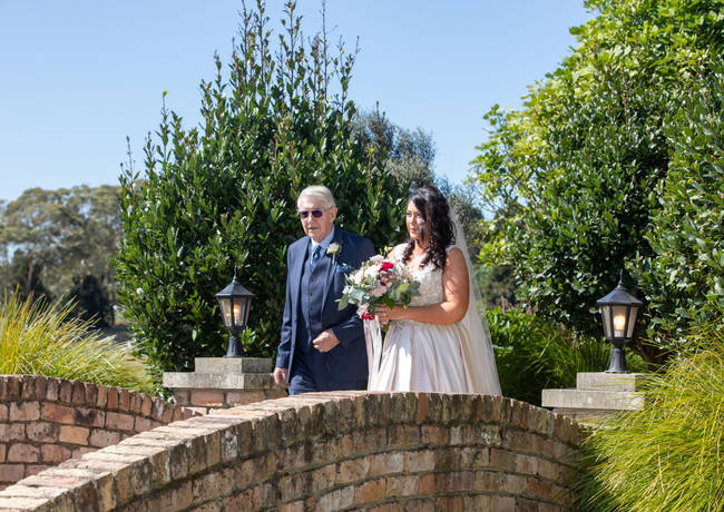 Bride and Father Walk To Wedding Ceremony