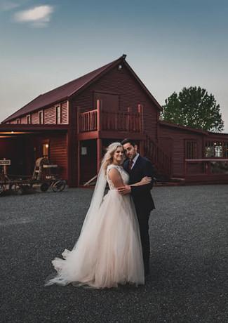 Bride & Groom Hug Infront of Barn