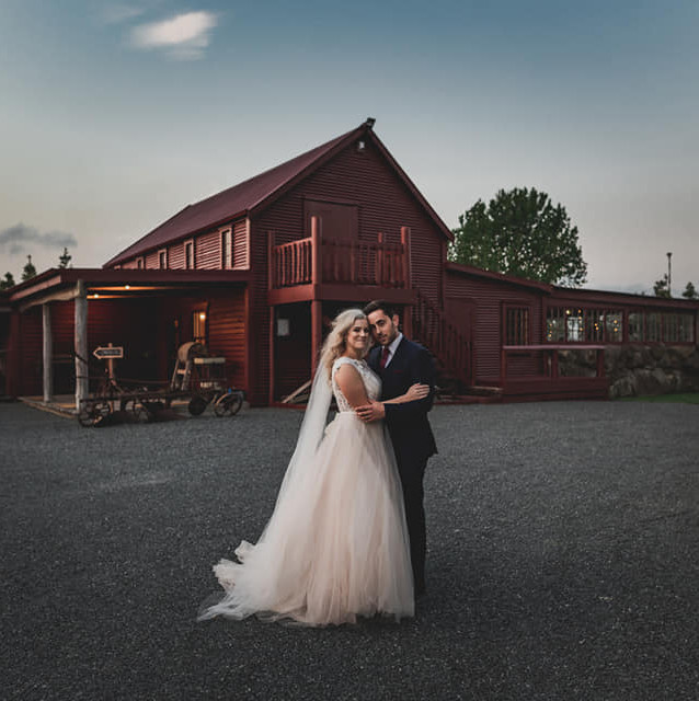 Bride & Groom Hug Infront of Barn