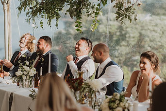 Bridal Party Laughing During Wedding Speeches
