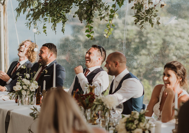 Grooms Party Laughing At Wedding Reception
