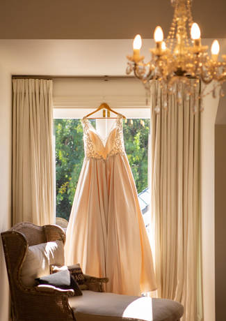 Bridal Gown Hanging At Window