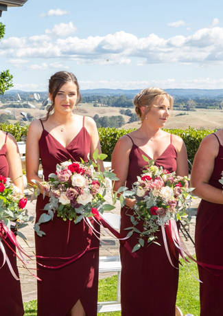 Bridesmaids In A Row At Ceremony