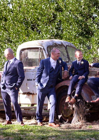 Groom With Groomsmen Sitting On Old Car