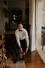 Groom Putting On Shoes In The Morining of The Wedding.jpg