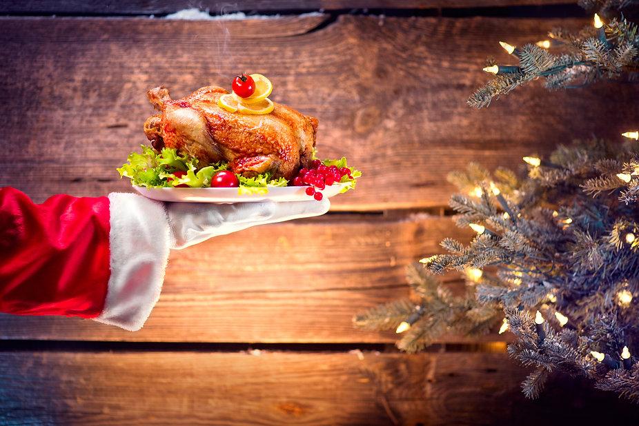 Christmas Holiday dinner. Santa Claus ha