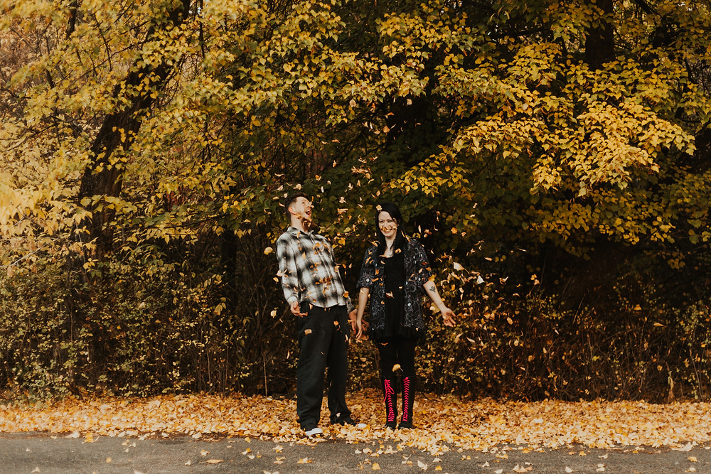 couples engagement session with a rainbow