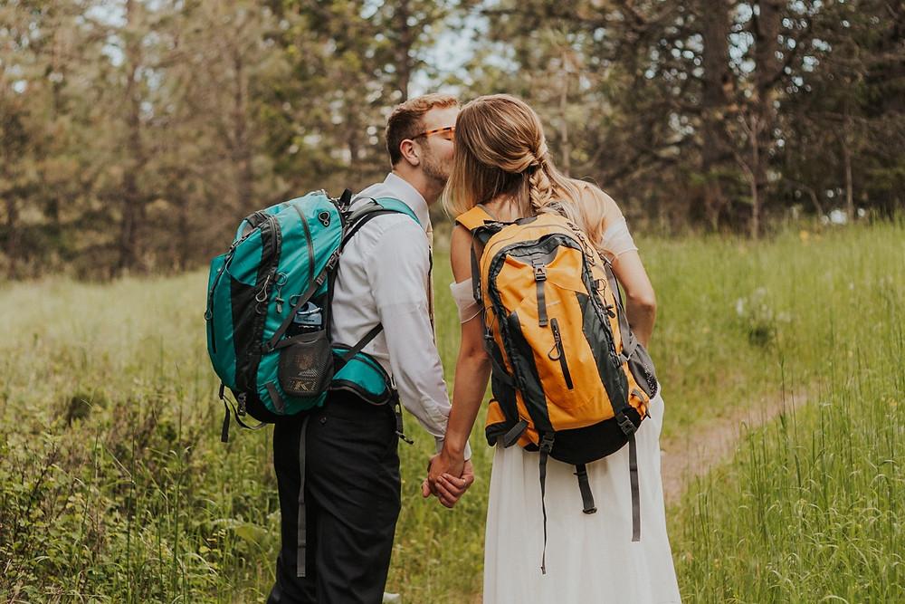idaho pacific northwest hiking bridals adventure bride and groom hiking backpacks trail