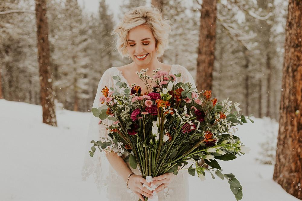winter wonderland elopement in mccall idaho forest bride