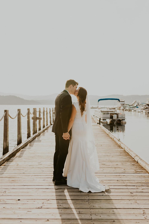downtown cda coeurdalene boardwalk cda resort sunset bridals lake coeur d alene boats bride and groom wedding photography elopement