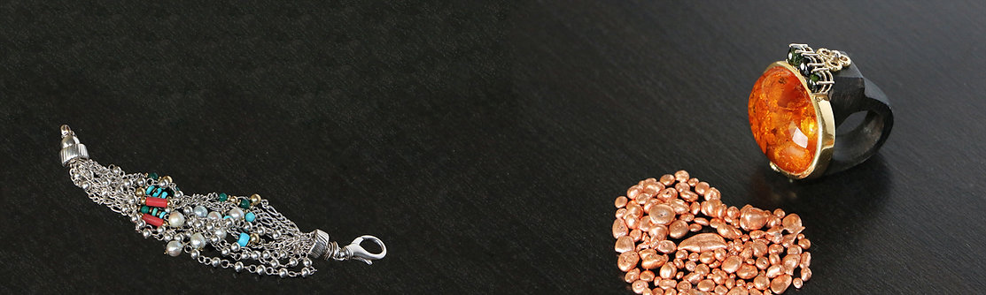 anello in oro 750 e ambra, bracciale in argento 925