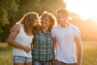 Cheerful happy caucasian family outdoors