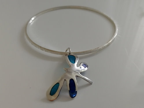 Solid sterling silver bangle with a dragonfly plique-a-joir charm